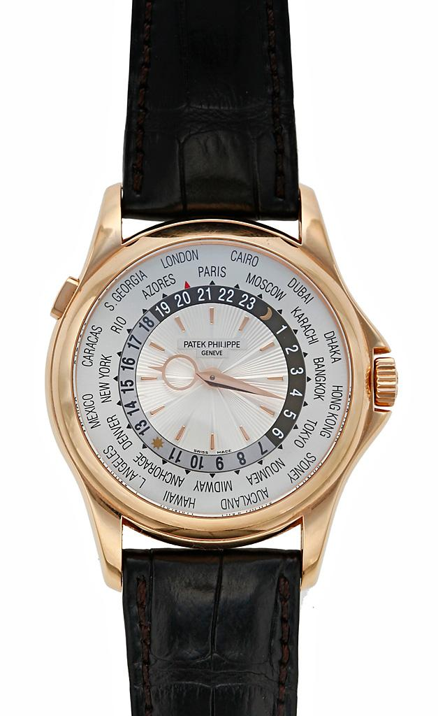 золотые часы Patek Philippe World Time